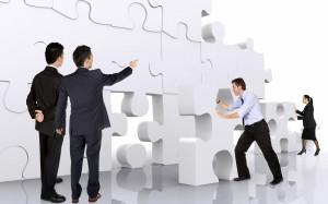 business teamwork - business men making a puzzle